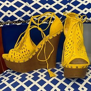 Mustard tie up studded high ankle bootie wedges